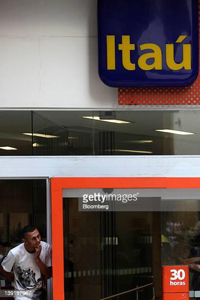 A man exits a Banco Itau BBA SA branch in Sao Paulo Brazil on Wednesday Feb 15 2012 Brazil's deposit insurance fund the nation's privately owned...