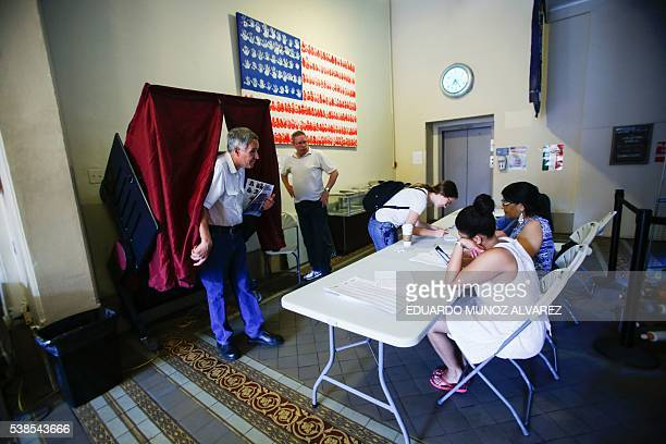 A man exits a booth after casting his ballot at polling station during New Jersey's primary elections on June 7 2016 in Hoboken New Jersey / AFP /...