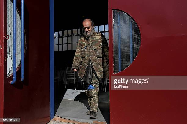 A man exits a closed gym where a New Year's Day lunch was given to people in need by the Reception and Solidarity Centre of the Athens municipality...