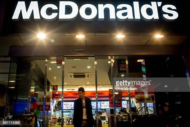 A man exits a McDonalds store in Meguro on January 7 2015 in Tokyo Japan McDonalds Japan was forced to pull 956925 nuggets made by a Cargill Unit in...