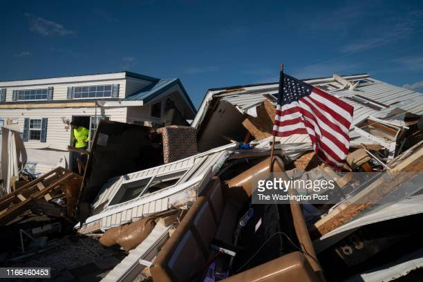 Man exits a mobile home amid damage from a tornado associated with Hurricane Dorian is seen at the Boardwalk RV Park the day after Hurricane Dorian...