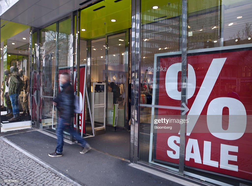 A man exits a retail store offering sales discounts in Berlin, Germany, on Wednesday, Feb. 27, 2013. German unemployment unexpectedly fell in February amid signs that Europe's biggest economy is returning to growth after a contraction at the end of last year. Photographer: Balint Porneczi/Bloomberg via Getty Images