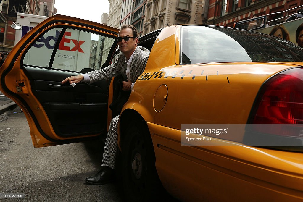 A man exits a taxi on September 4, 2012 in New York City. As of Tuesday, yellow taxis may begin charging more following an approved fare increase for riders. Taxi rates have remained virtually unchanged since 2006 and will now rise by an expected 17 percent.