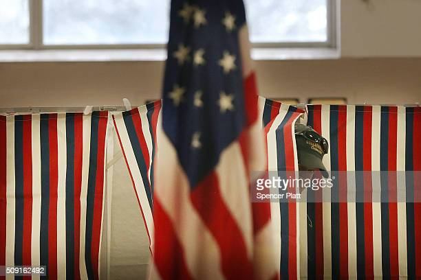 A man exits a voting booth inside of a middle school serving as a voting station on the day of the New Hampshire Primary on February 9 2016 in Bow...