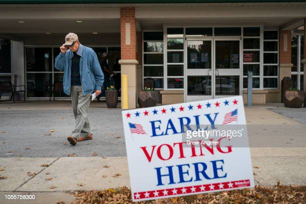 A man exits an early voting polling place at the Williamson County Clerk's office October 31 2018 in Franklin Tennessee US Rep Marsha Blackburn who...