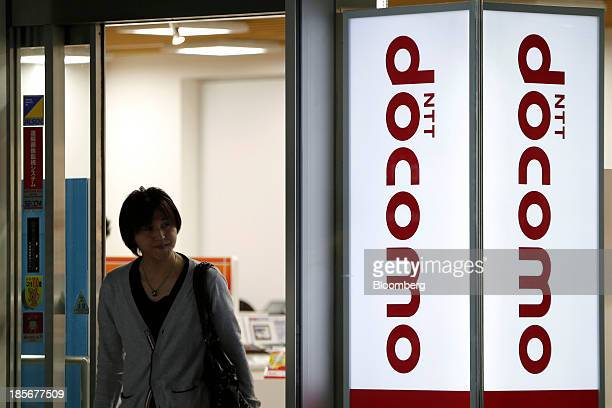 A man exits an NTT Docomo Inc store in Tokyo Japan on Wednesday Oct 23 2013 DoCoMo Japan's largest mobile phone carrier is scheduled to release...