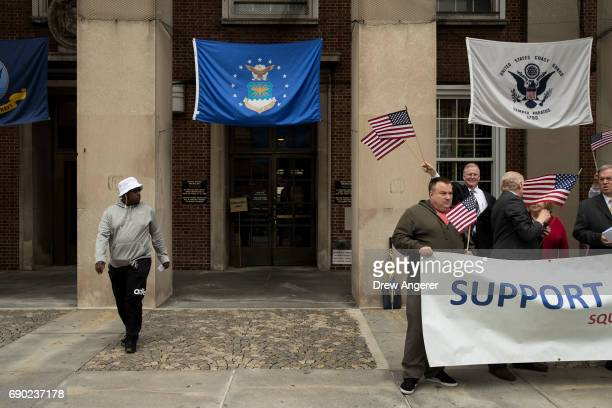 A man exits the building as supporters of Joe Concannon a retired NYPD captain and current candidate for NYC City Council District 23 cheer during a...