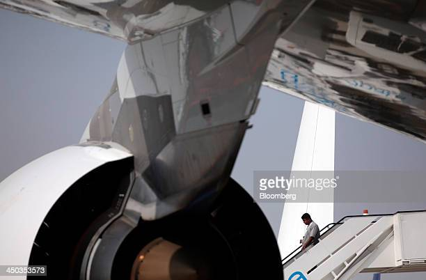 A man exits the cabin of a Emirates Airline Airbus A380 aircraft as its stands on static display during the 13th Dubai Airshow at Dubai World Central...