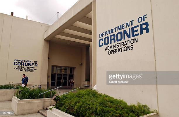 Man exits the Los Angeles County Coroners office April 16, 2002 in Los Angeles, CA. Some coroner employees, represented by Service Employee Union...