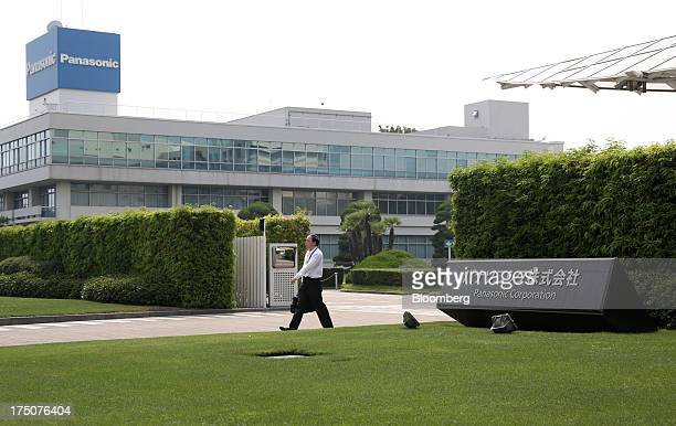 A man exits the Panasonic Corp headquarters in Kadoma Osaka Prefecture Japan on Wednesday July 31 2013 Panasonic Japan's biggest consumer electronics...