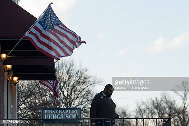 A man exits the polling station after casting his ballot during Missouri primary voting at the First Baptist Church of Ferguson on March 15 2016 in...