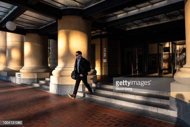 A man exits the Wellington Railway Station in Wellington New Zealand on Wednesday July 18 2018 New Zealand inflation picked up in the second quarter...