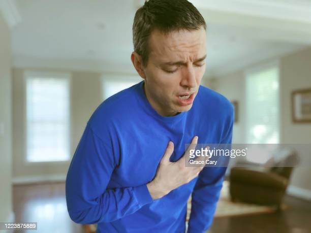 man experiences shortness of breath - problems stock pictures, royalty-free photos & images