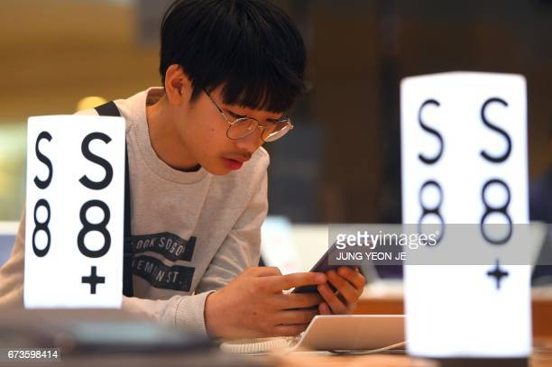 A man experiences the Samsung Galaxy S8 smartphone at the company's showroom in Seoul on April 27 2017 South Korean tech giant Samsung Electronics...