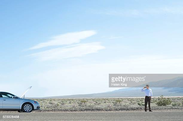 Man experiencing car trouble