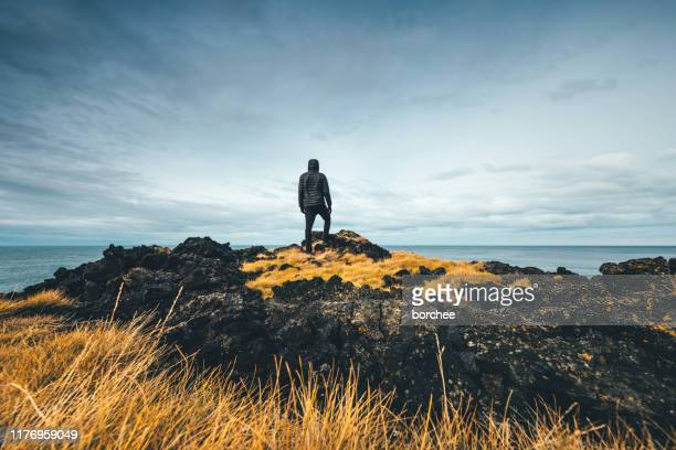 man exploring iceland - wonderlust stock pictures, royalty-free photos & images