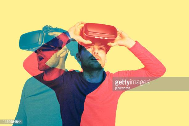 man exploring virtual reality. double exposure - novo imagens e fotografias de stock