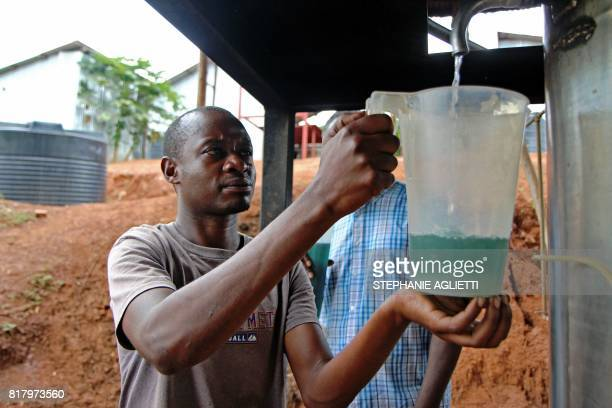 A man extracts geranium oil at a small factory in Gahara in the Southeast of Rwanda on April 28 2017 Last year Rwanda exported around 14 tonnes of...