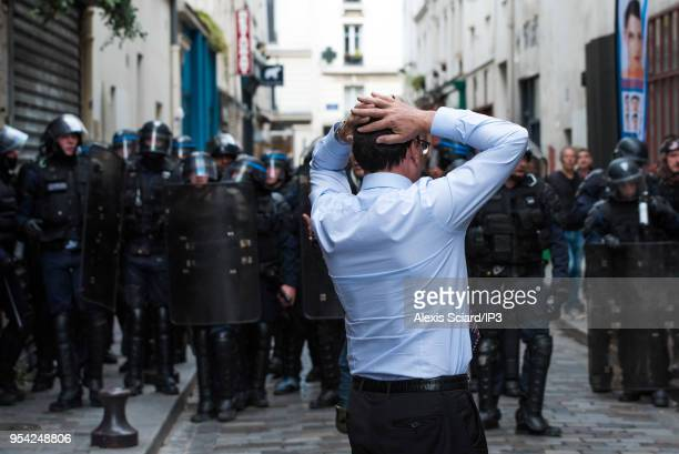 Man faces CRS at May 1 demonstration on May 1 2018 in Paris France Several hundred protesters defied the CRS and degraded street furniture on the...