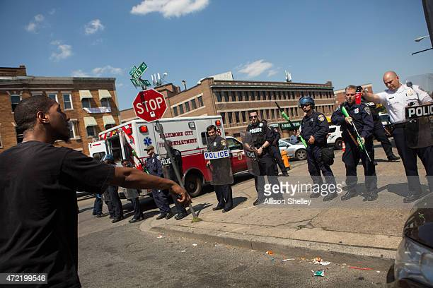 A man faces off with police on North Ave near the site of recent riots and several blocks away from where Freddie Gray was arrested last month May 4...