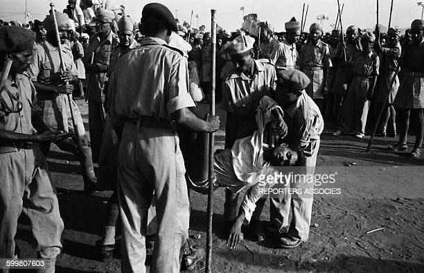 Man Fainting During The Cremation of Nehru On the Banks Of the Yamuna River in India on May 29 1964