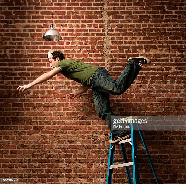 man falling from ladder - achteloos stockfoto's en -beelden