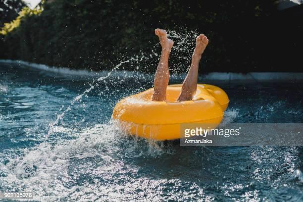 man falling into water in the swimming pool - calzoncini da bagno foto e immagini stock