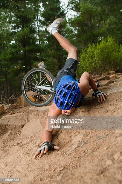 Man falling off mountain bike