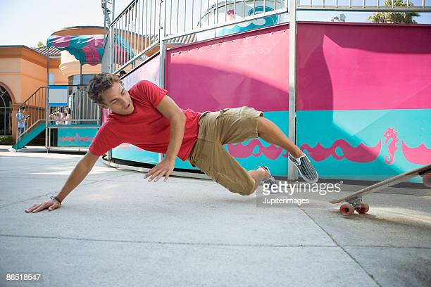 Man falling off skateboard