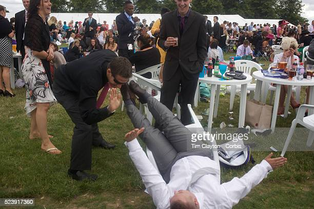 'A man falls from his chair during the race meeting at Royal Ascot Race Course Royal Ascot is one of the most famous race meetings in the world...