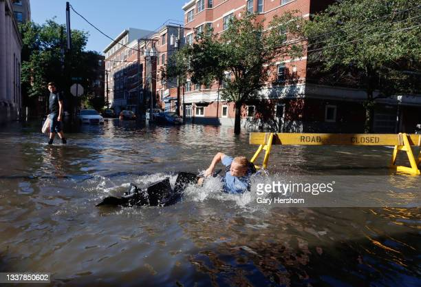 Man falls off his bike into a flooded street the morning after the remnants of Hurricane Ida drenched the New York City and New Jersey area on...