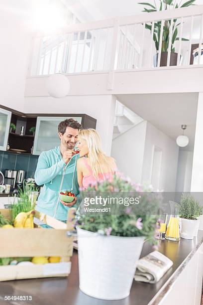 Man feeding his girlfriend with strawberries