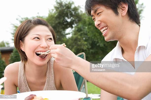 Man Feeding to Woman