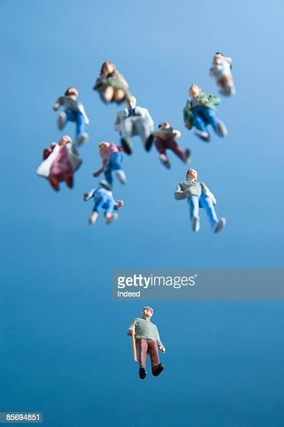 Man figurines in sky
