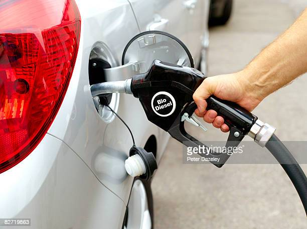 Man filling car with Bio diesel pump