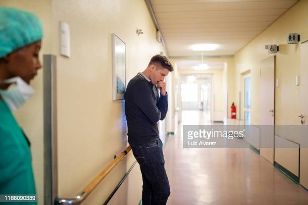 man filling nervous while waiting in hospital corridor - fear stock pictures, royalty-free photos & images