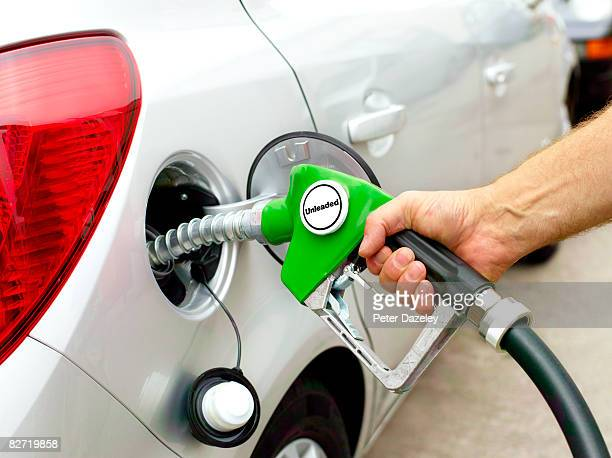 Man filling up car with unleaded fuel