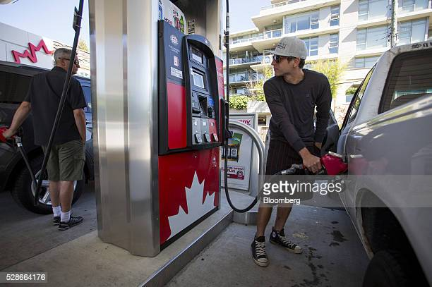 A man fills a car with fuel at a PetroCanada gas station in Vancouver British Columbia Canada on Friday May 6 2016 The worst wildfire in Alberta...