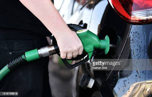 Man fills a car with Unleaded Petrol at Asda petrol station on May 07, 2021 in Stoke-on-Trent, England. The Asda owners are set for a £6.8bn buyout...