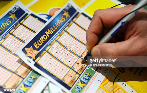A man fills an Euro Millions lottery ticket on November 5 2012 in Tours central France Gamblers across Europe are to go neckandneck for a chance to...