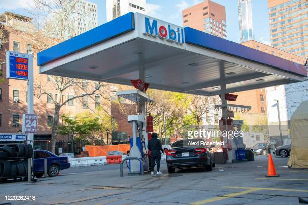 A man fills his car up with gas amid the coronavirus pandemic on April 21 2020 in New York City United States COVID19 has spread to most countries...