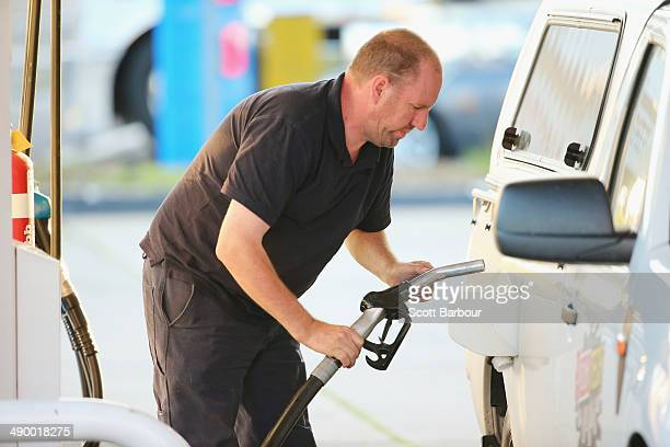 Man fills his car up with petrol on May 13, 2014 in Melbourne, Australia. Tony Abbott's Coalition government will deliver it's first federal budget...