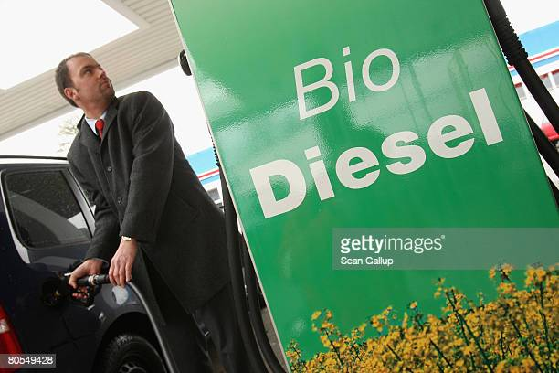 A man fills his car's tank with gasoline at a gas station that also sells biofuels on April 7 2008 in Berlin Germany The German government recently...
