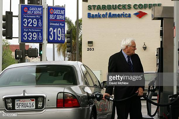 A man fills his tank at a gas station advertising prices that are typical of the area well above the $3 per gallon mark on April 25 2006 in the Los...