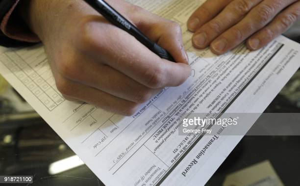 A man fills out a federal background check form at Good Guys Guns Range on February 15 2018 in Orem Utah An AR15 was used in the Marjory Stoneman...