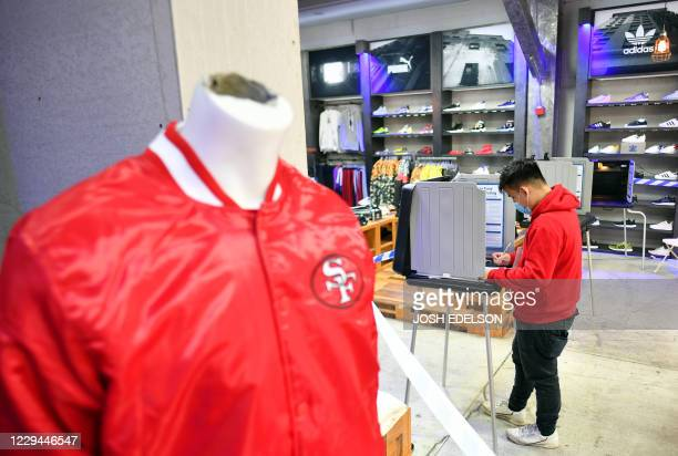 A man fills out his ballot at a Shiekh shoe store on election day in San Francisco California on November 3 2020 The US started voting Tuesday in an...