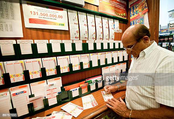 A man fills out his SuperEnalotto lottery ticket in a shop in central Rome on August 12 2009 Italy's lottery prize has risen to a world...