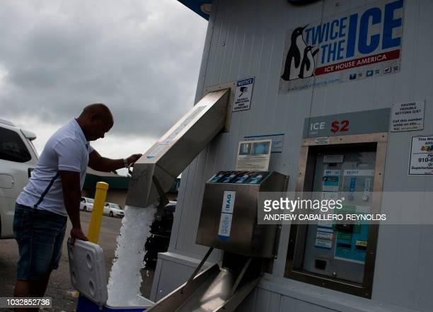 A man fills up a cooler with ice before Hurricane Florence makes landfall in Wilmington North Carolina on September 13 2018 Hurricane Florence edged...