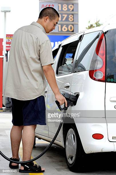 A man fills up his car at a gas station in Tokyo Japan on Wednesday July 9 2008 Japan's consumer prices probably rose at the fastest pace in a decade...