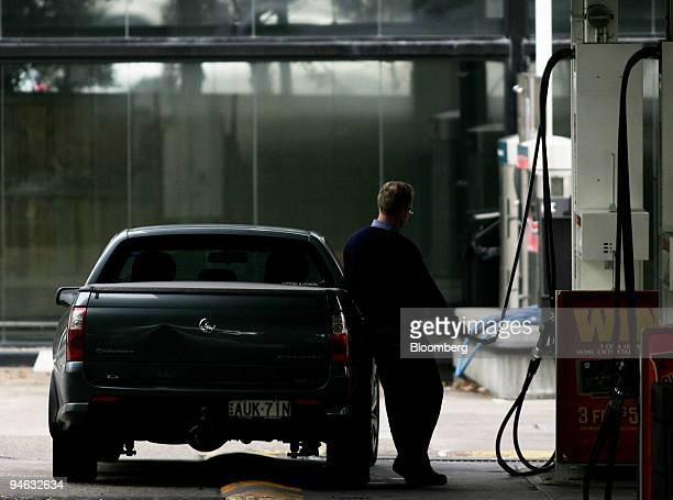 A man fills up his car with gasoline at a Caltex service station in Sydney Australia on Thursday Aug 23 2007 Caltex Australia Ltd the nation's...